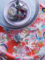 Jewellery on table with Oriental-style, floral surface