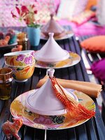 Table set in Oriental style with small tagine-like dishes