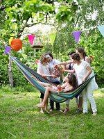 Girls eating ice cream at birthday party in garden