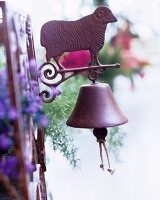 Vintage, metal 'dinner bell' decorated with a sheep on a garden gate