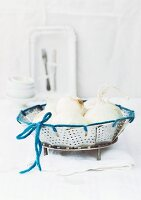 Steamer insert tied with blue cord and used as basket