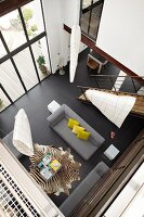 Bird's eye view of a modern living room with black tile floor and floor to ceiling windows