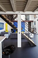 Steel stairs in a modern, open living room with a loft like feel