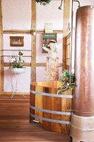 Bathroom with free-standing wooden bathtub
