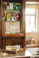 Wooden bathroom cabinet with glass door