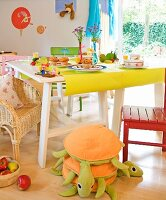 Dining table with muffins and orange juice in a playroom
