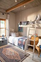 Country style, teenage bedroom: wooden ceiling with a hanging bed and D-I-Y ladder
