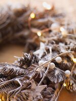 Advent wreath made from pine cones and snowberries