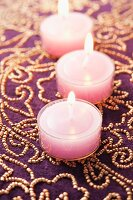 Pink tealights on luxury beaded tablecloth