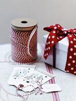 Festive gift tags, ribbon and gift box
