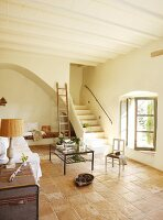 Bright interior with terracotta tiles and simple furnishings in Spanish, Mediterranean style