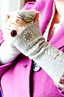 Grey wool felt wrist warmers decorated with star-patterned ribbon