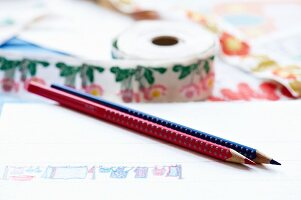 Hand-drawn pattern on white paper with red and blue coloured pencils