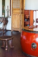 Large drum with metal fittings and ethnic, wooden stool