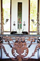 Elegant crystal carafes on rusty, wrought iron console table