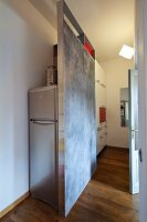 DIY partition screening fridge in modern kitchen