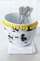 Mickey Mouse bowls decorated with yellow pompom trim
