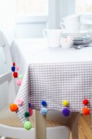 Tablecloth decorated with colourful pompoms