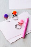 Paper clips decorated with pompoms