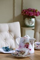 Floral tea set, linen napkin and beaded napkin ring