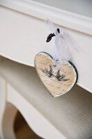 Heart-shaped pendant hanging from drawer key