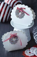 White, cloud-shaped, festive cardboard gift boxes with sugar sprinkle rings
