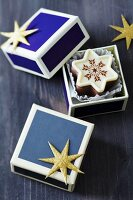 Star-shaped Christmas chocolates in small blue boxes with gold glittery stars