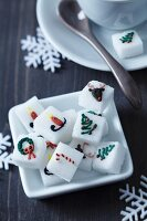 China dish of sugar cubes with Christmas motifs in food colouring