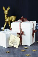 White gift boxes with tartan ribbon and gift tag