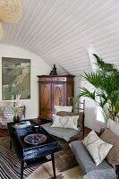 Eclectic mixture of styles in interior below wood-clad barrel vault