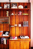 Various ornaments on wooden shelving unit