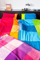 Colourful bed linen & checked wool blanket