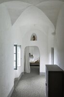 View from hallway into bedroom in former monastery; figure of Madonna in niche