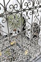 View down into Moroccan courtyard through artistically crafted iron balustrade