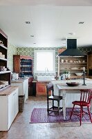 Country-house kitchen with dining table and chairs in various styles