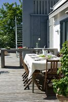 Set table on roof terrace with wooden decking