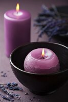 Purple candles and lavender flowers