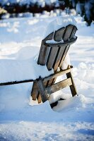 Snow Covered Wooden Chair