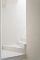 Winding staircase as purist white architectural sculpture