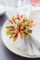 Pompom made from paper cake cases as napkin ring