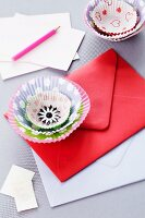 Flower decoration made from paper cake cases on envelope