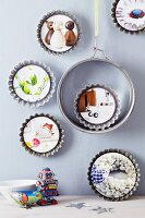 Cake tin and tart tins used as picture frames