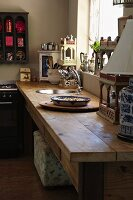 Rustic wooden kitchen counter with integrated sink