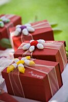 Boxes of chocolates with crocheted flowers for wedding guests
