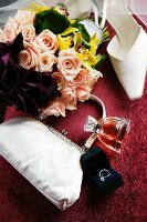 White bridal bag, rings, perfume, shoes and bouquet