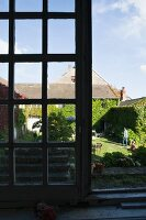 View out a window of a former monastery across to the guest house