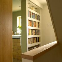 Bookcase between the bathroom and stairs