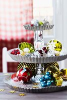 Arrangement of Christmas decorations on cake stand upcycled from tart tins