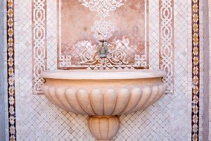 Oriental wall fountain with mosaic tiles
