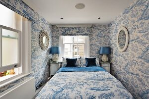 Bedroom in fresh blue and white with toile tree pattern on both wallpaper and textiles